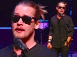Actor turned musician: Macaulay Culkin, pictured posing with a fan, performed with his band, The Pizza Underground for children at NYU's Skirball Center on Saturday