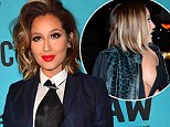 Adrienne Bailon covers up at press conference for G-Star and Pharrell William's Raw for the Oceans denim project after nearly having a wardrobe malfunction night before