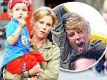 It must have been a VERY fun ride! Julie Bowen squeals and flails about on children's attraction at Disneyland