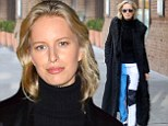 That's one way to make an entrance! Karolina Kurkova dons flashy trousers and dramatic fur-trimmed coat at New York Fashion Week