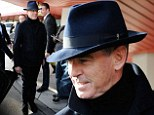 Flash in a fedora: Pierce looked very smart as he touched down at Berlin Tegel Airport