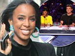 I'm a Survivor! Kelly Rowland looks cheerful at NYFW following news that The X Factor USA will not be returning
