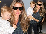 Model in the making! Gisele Bundchen's daughter Vivian gives the cameras a smile as they arrive at Los Angeles airport