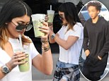 Kylie Jenner embraces the grunge trend by donning ripped jeans and flannel tied around her waist as she grabs two healthy green drinks... Could one be for rumoured beau Jaden Smith?