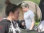 Jennifer Lopez steps off private jet make-up free in Miami before toyboy Casper Smart heads out on the town