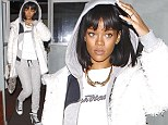 She'd look good in anything! Rihanna heads out to dinner in an all-white tracksuit... following night out with Drake