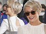 Dancer and actress Julianne Hough seems happy with her new pixie cut  as she laughs while running to catch a flight from LAX Airport Sunday