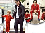 Dad's little Royal Tenenbaum! Robin Thicke's son Julian adorably rocks a matching tracksuit for a boys' day out