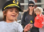 Already a true gentleman! Little Mason presents his mother Kourtney Kardashian with a flower during a family shopping trip