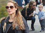 Elizabeth Berkley feeds milk to her son at the farmers market