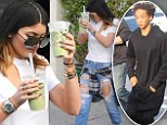 Kylie Jenner goes grunge in ripped jeans and flannel while sipping on green smoothie... as rumoured beau Jaden Smith goes shopping