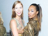 Up close and very personal: Jourdan Dunn grabbed an ample handful of Karlie Kloss' cleavage backstage at the Diane Von Furstenberg show during New York Fashion Week on Sunday
