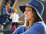 They're my babies! Jessica Alba is becoming in blue as she dotes on her little girls during family day at the park