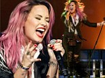 Demi Lovato forgets about X Factor disappointment by donning racy miniskirt for concert in Canada