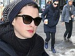 Actress Anne Hathaway and husband Adam Shulman walk through slushy New York streets Sunday afternoon to catch a Broadway play