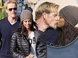 Sealed with a kiss! Tyra Banks and new boyfriend Erik Asla share a passionate smooch while on romantic lunch date