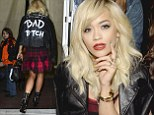 Rita Ora steps out in eye-catching leather jacket and tartan minidress for DKNY runway show in New York