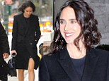 Jennifer Connelly flashes her trim pins in smart black wool coat and sandals for Fashion Week event