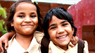 Two Cheerful Playful Little Indian Girls