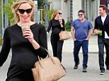 Heavily pregnant Emily Blunt displays her bump in all black while out for a stroll with husband John Krasinski