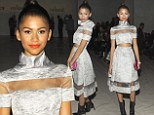 Zendaya Coleman displays her edgy style as she pairs black ankle boots with pretty silver skirt and cropped top at NYFW