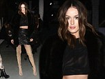 Australian model Nicole Trunfio flaunted her sexy sense of style in a leather mini skirt and a nude version of her previously worn lace-up boots at New York Fashion Week on Tuesday