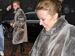 Kylie Minogue gets caught in a downpour