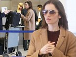 She'll be In the Air Tonight: Lily Collins is the anti-diva as she queues to hand over her own luggage at LAX