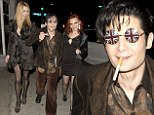 You can BOTH Stand By Me: Corey Feldman wears Union Flag glasses as he leaves Hollywood club with two young ladies