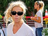 Pump up the volume! Denise Richards struggles to contain her messy hair as she grabs some gas