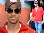 Sexy Enrique Iglesias sends hearts racing in bright orange shirt as he arrives in Puerto Rico ahead of Valentine's Day concert