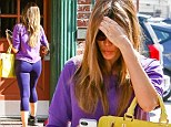 Not a shrinking violet! Sofia Vergara shows off her toned body in tight, clashing purple gym gear