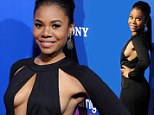 Talk about daring! Regina Hall narrowly avoids a wardrobe malfunction as she sports a VERY revealing jumpsuit to About Last Night premiere