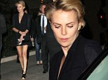 Evening elegance: Charlize Theron wows in a little black dress on date with Sean Penn