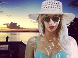 She's certainly a trailblazer! Bikini-clad Beyonce shares more holiday snaps and the Hindu word 'nayka' meaning 'leader'