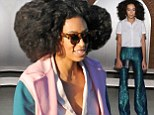 Style range: Solange Knowles toned it down on Tuesday for the Marc Jacobs fashion show in New York City after rocking metallic green mermaid-like pants at the Wes Gordon show during Mercedes-Benz Fashion Week