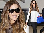English beauty: Kate Beckinsale flashed her winning smile on Tuesday as she arrived at Los Angeles International Airport