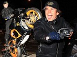 The Lord Of The Wheelies: Orlando Bloom sticks out his tongue as he lets off some steam on 'Deth Killers' motorbike