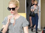 Nautical but nice: January Jones wears high-waisted trousers with blue striped shirt as she cools down with ice-cold drink