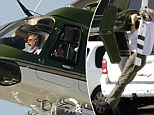 Still a superhero! Harrison Ford, 71, takes his helicopter out for a solo spin but not before doing pull ups on its tail boom