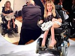 The first wheelchair model