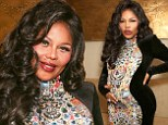 'This baby has made me even more of a beast': Lil' Kim insists she's 'still going to be hardcore' as a mother after confirming pregnancy