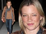 From bland to brilliant! Amy Smart dresses up her brown top and blue jeans with matching tie-dye scarf while out to dinner