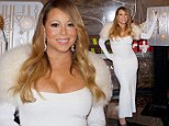 It's not your wedding! Mariah Carey dresses in her sexiest white dress yet to light up the Empire State Building for Valentine's Day