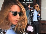 Blake's hair is looking Lively as she ventures out in New York with minder sheltering her under umbrella
