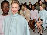 Gunning for the cover? Lupita Nyong'o and Naomi Watts look pretty in pastel as they cozy up to Vogue editor Anna Wintour at the Calvin Klein fashion show