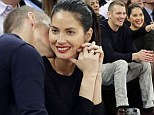 Romance Cop: Olivia Munn gets some courtside affection from Joel Kinnaman at the New York Knicks game
