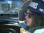 Kristen Stewart goes incognito in baseball cap and sunglasses as she cruises around LA in her black SUV