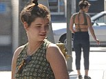 Life's no drag for Pixie! Miss Geldof steps out in backless floral top and cropped jeans as she enjoys cigarette during trip to LA