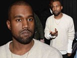 Sorry, Kim¿s busy! Kanye West looks apologetic as he arrives at premiere without his Kardashian fiancée